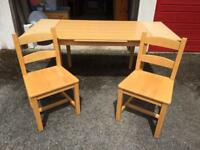 Extendable dining table and two solid beech chairs