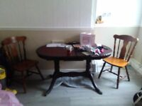 Extending dining table and 2 chairs