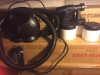 Tanning machine with spraying gun