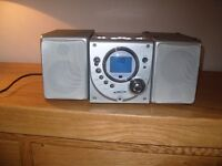 Silver colour CD/Radio stereo system. with speakers & remote control.