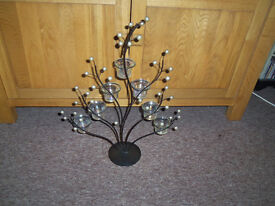 metel tea light holder with glass holders. nice for living or dinning area..