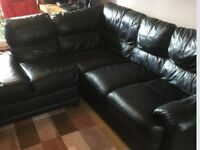 Black leather corner sofa, in vgc could deliver