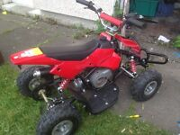 49cc kids quad selling for Spain's and repairs it has a snaped engine cover And