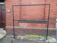 "6'6"" High sturdy clothes rail with extension bar on extra rail in the middle."