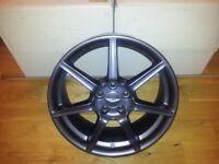 Genuine set of 4 Aston Martin 7-spoke alloy wheels with centre caps
