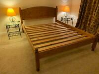 Large solid wood bed with metal side tables