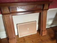 Wooden fireplace and solid marble inset and hearth