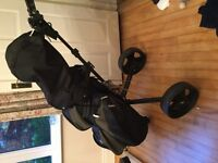 Complete set of barely used Spalding golf clubs, with bag, trolley, etc