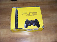 Boxed Playstation 2 PS2 Slim with Bundle of kids games and extras