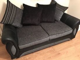 Large 2 seater sofa (cushion back) and 2 arm chairs charcoal grey and black.