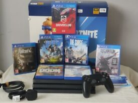 ps4 pro with 7 games bundle rarely used open to offers