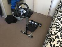 Logitech G25 wheels with pedals and H shifter mounted to a wheel stand pro.