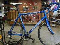 Genius 56cm road bike with carbon fork