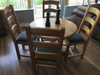 Oak Round leaf drop table and 4 oak dining chairs