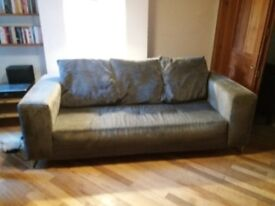Dark grey sofa. Sits 2-3 people and is very comfortable