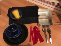 Bundle of camping dishes, pans and pillows