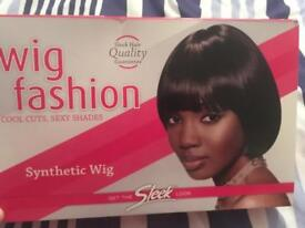 Black synthetic short wig - new still with tags on