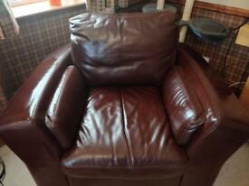 Two large brown leather armchairs (1 recliner)