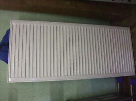 1400x 600 white radiator double with grille on top