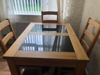 Extended dining room table and 4 chairs with matching sideboard
