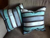 THREE CUSHIONS SHADES OF BLUES STRIPPED DESIGN, ZIPPED, PLAIN BLACK BACK GOOD CONDITION