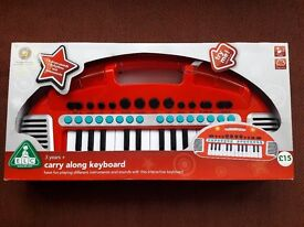 BRAND NEW, BOXED.Early Learning Centre Red Carry Along Keyboard