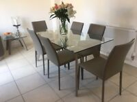 Dining table/6 chairs/matching coffee table/18 piece dinner service/6 wine glasses/mats & napkins