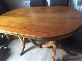 Pine Solid Dining Table. top is scratched as shown in picture. Dismantled ready for collection..
