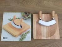 Curved centre chopping board with double sided rocker.