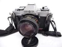 MINOLTA XG-1 SLR CAMERA PLUS 50mm lens.