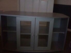 silver,t.v.unit,with shelves&glass doors.