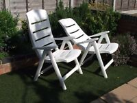 Reclining white resin chairs x2