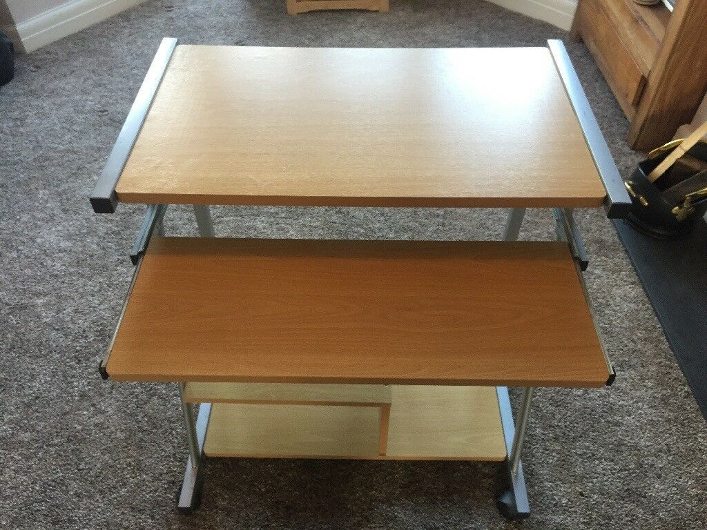X 2 Glass and wooden Computer Tables with wheels