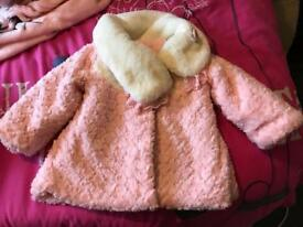 Girls lovely pink fluffy coat.