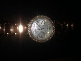Girls Michael Kors chronograph watch.