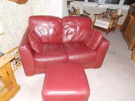 2 used leather sofas and leather footstool.1 three seater,1 two seater.collection only.£150 ONO.