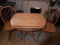 Wooden kitchen/ dining table and 2 chairs