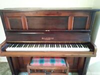 1910 upright iron framed piano.