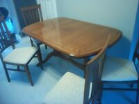 Quality dining room table and four chairs