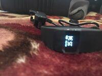 Fitbit type fitness tracker.