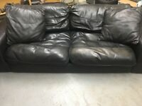 Black leather sofa, footstall and matching cushions