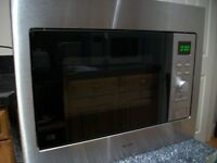 microwave built in only 7 month old, cost over £200 new