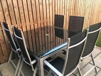 8 Seater table and chairs with umbrella..