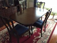 Hardwood Dark oak coloured solid wood dining table and 4 chairs