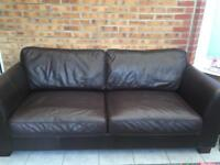 Dark brown leather sofa and arm chair