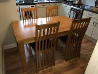 Solid oak dining room table and chairs £100