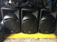 Three Mackie SRM450 mark 2 powered speakers.