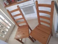 2 Ikea wood chairs