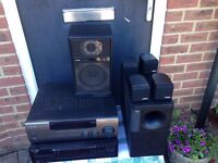 Bose Acoustimass 6 home theatre system + Amp + CD player. Love great sound this is for you.