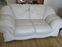 2 cream leather sofas and chair